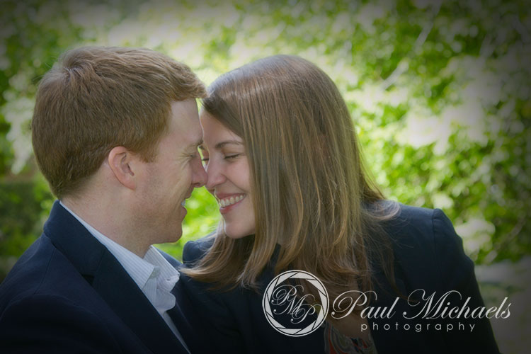 Engagement portraits with young couple at botanical gardens.