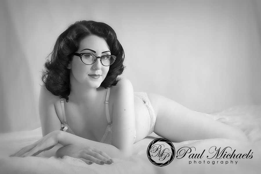 Black and white boudoir photo in the studio.