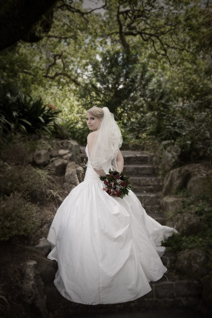 Bride on the garden stairs