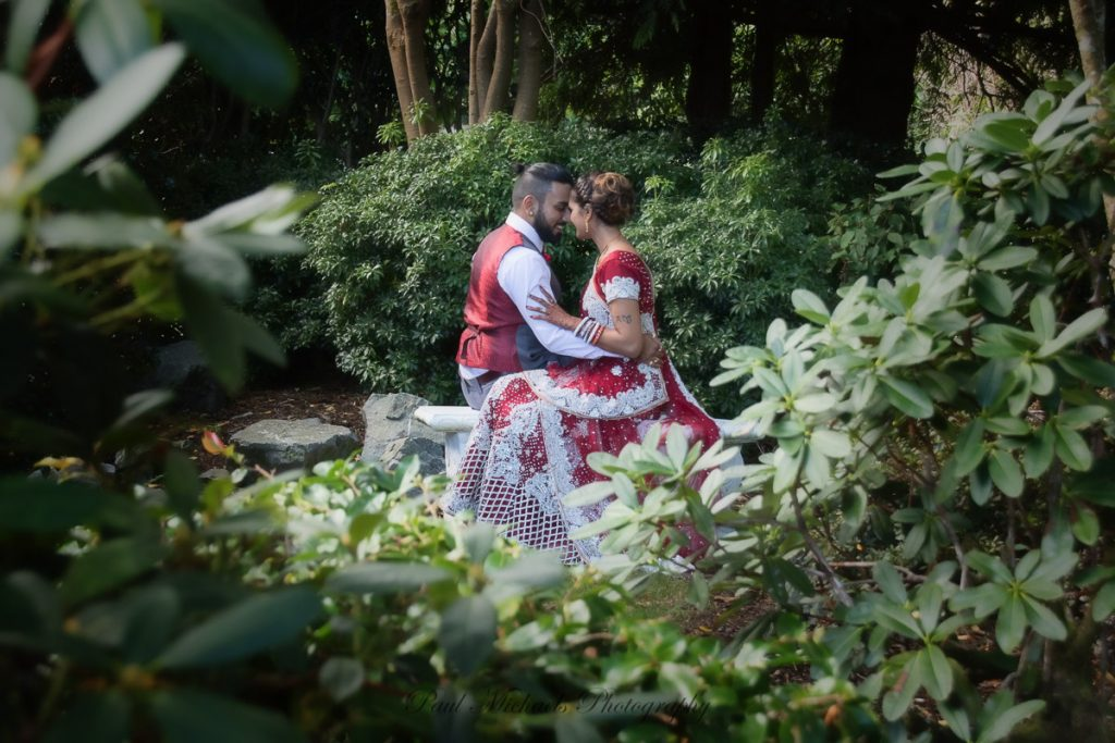 Indian couple sitting in Kaitoke gardens