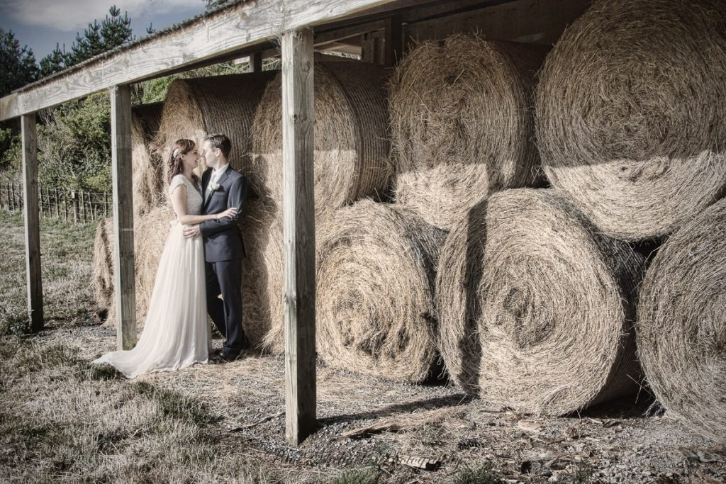 By the hay bails