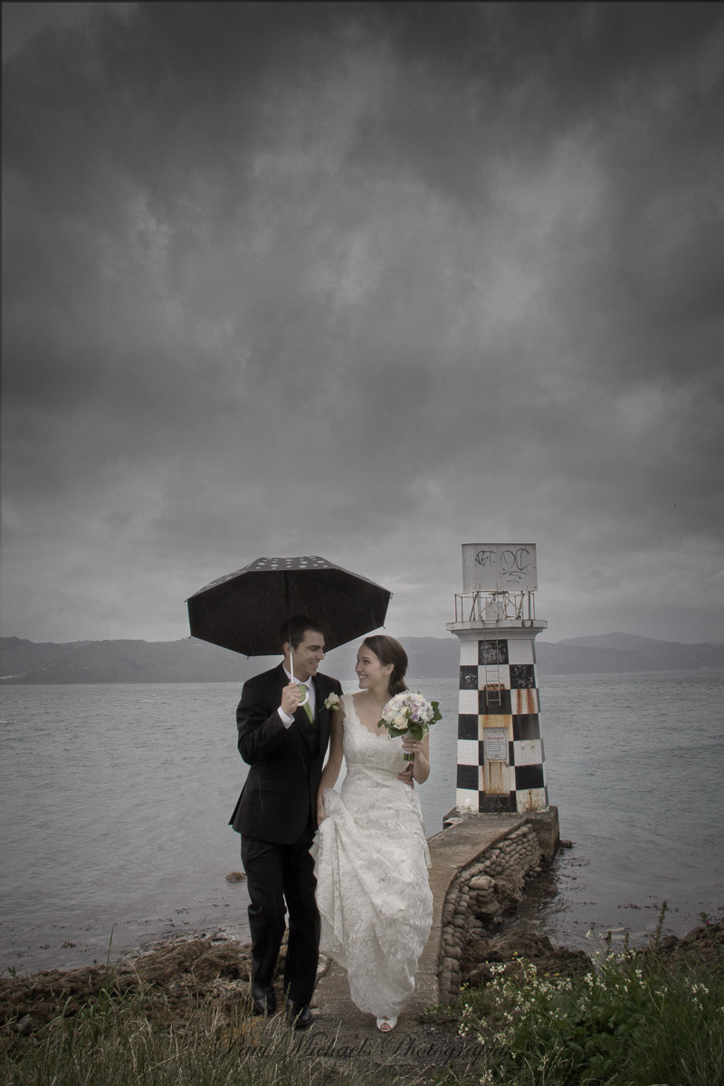 Bride and grrom at Point Halswell lighthouse wellington
