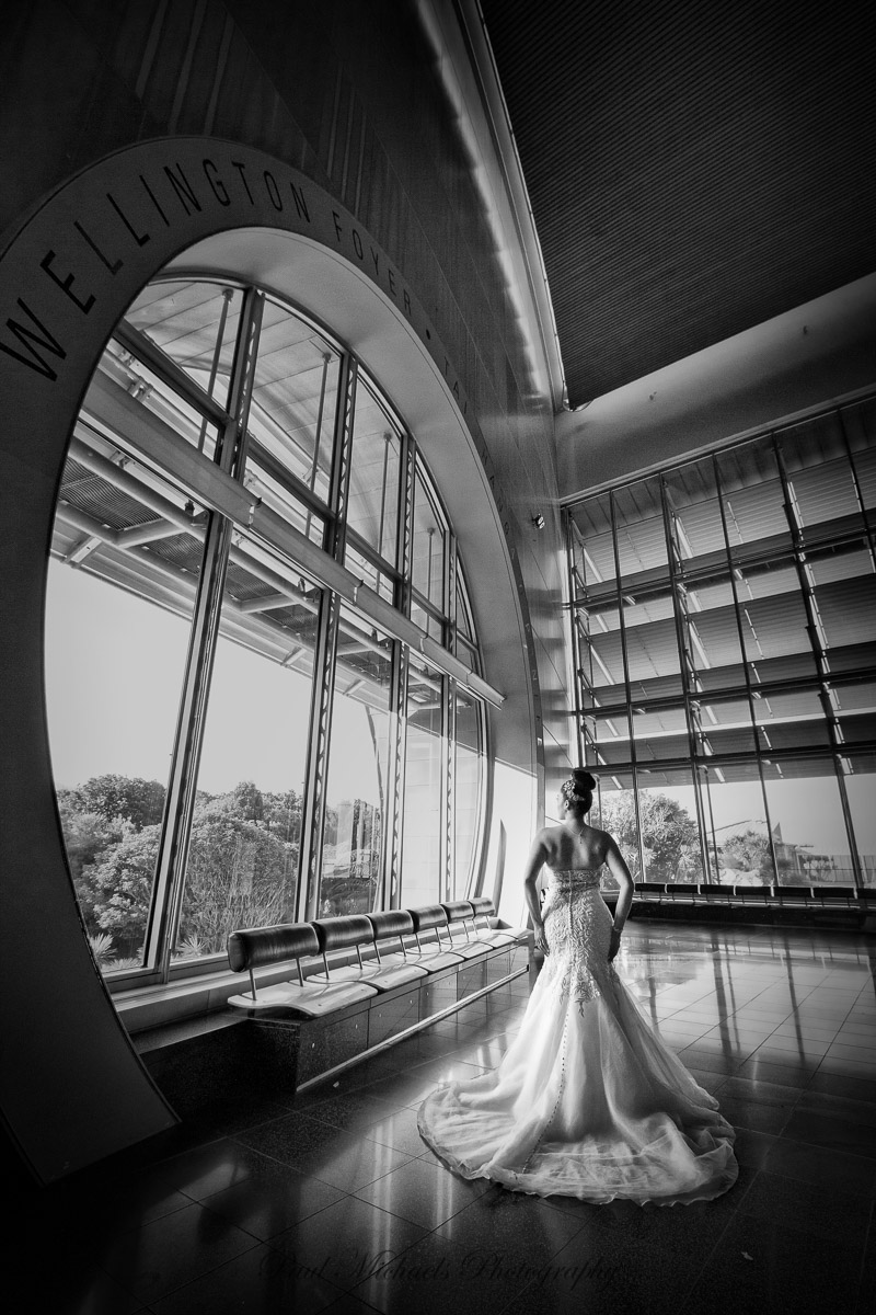 Bride by the big window at the museum