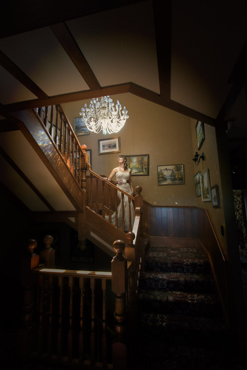 Bride on the stairs at the Woodroyd estate