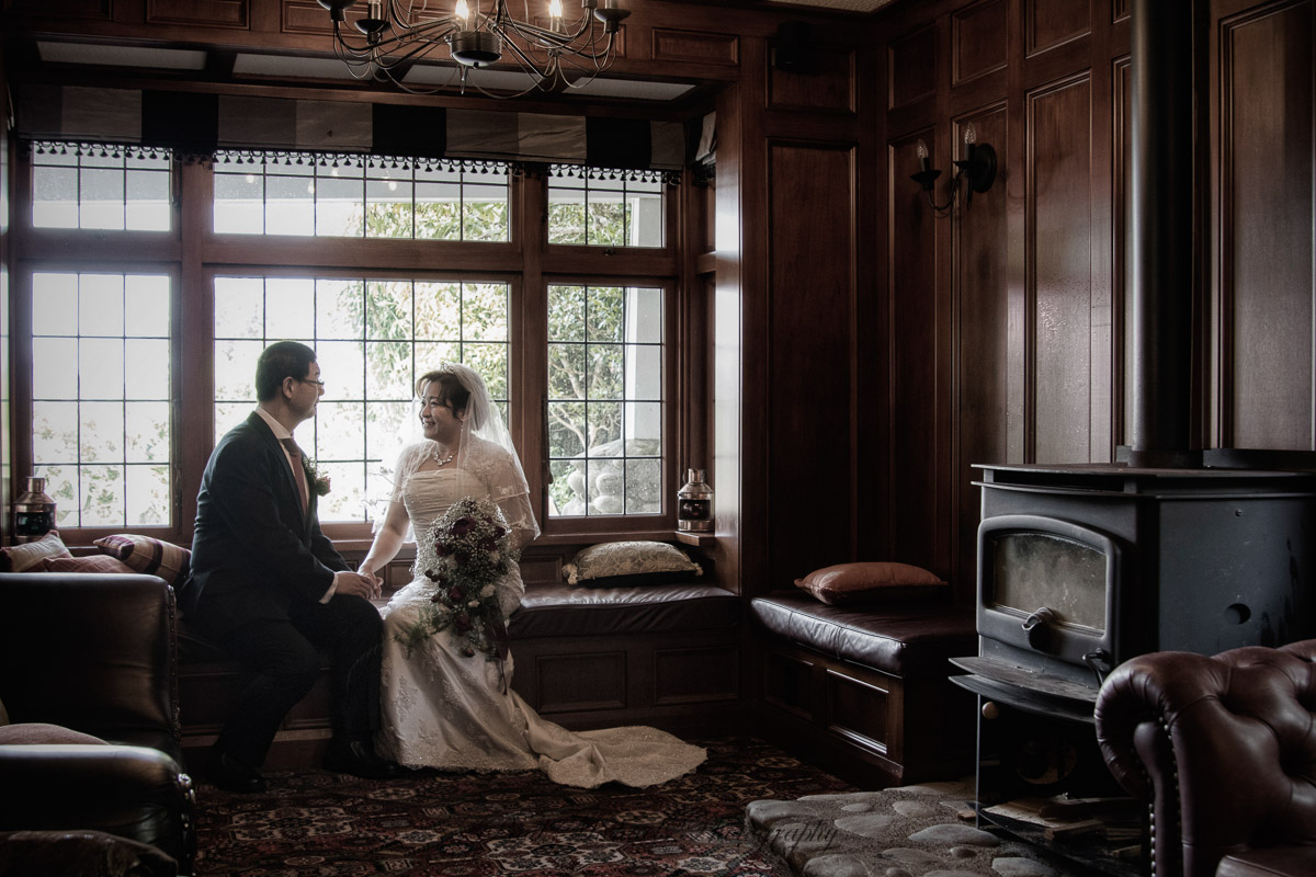 wedding couple by the window