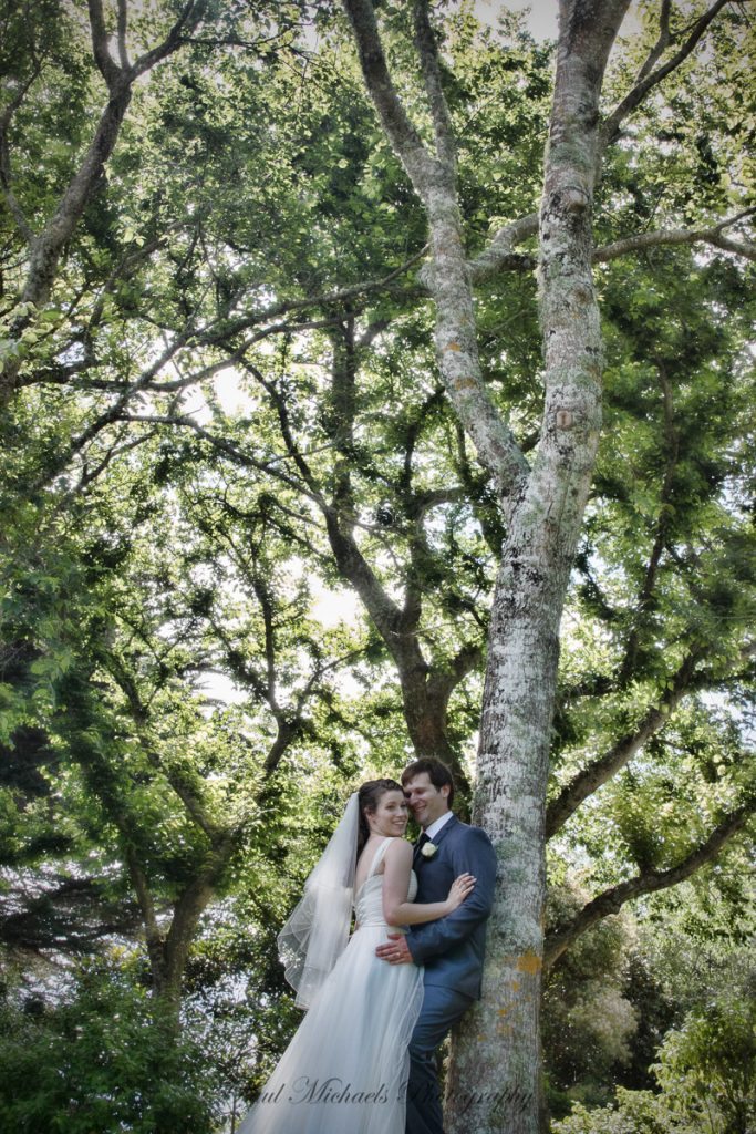 Bride and groom by the trees