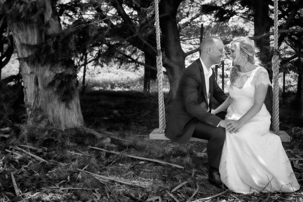 Bride and groom on the swing