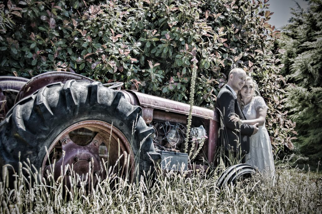Couple by the old tractor