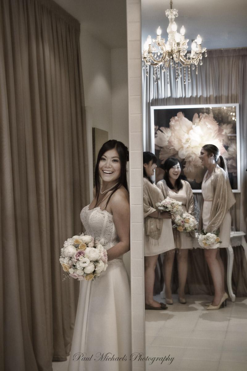 Bride and bridesmaids having fun at museum hotel.