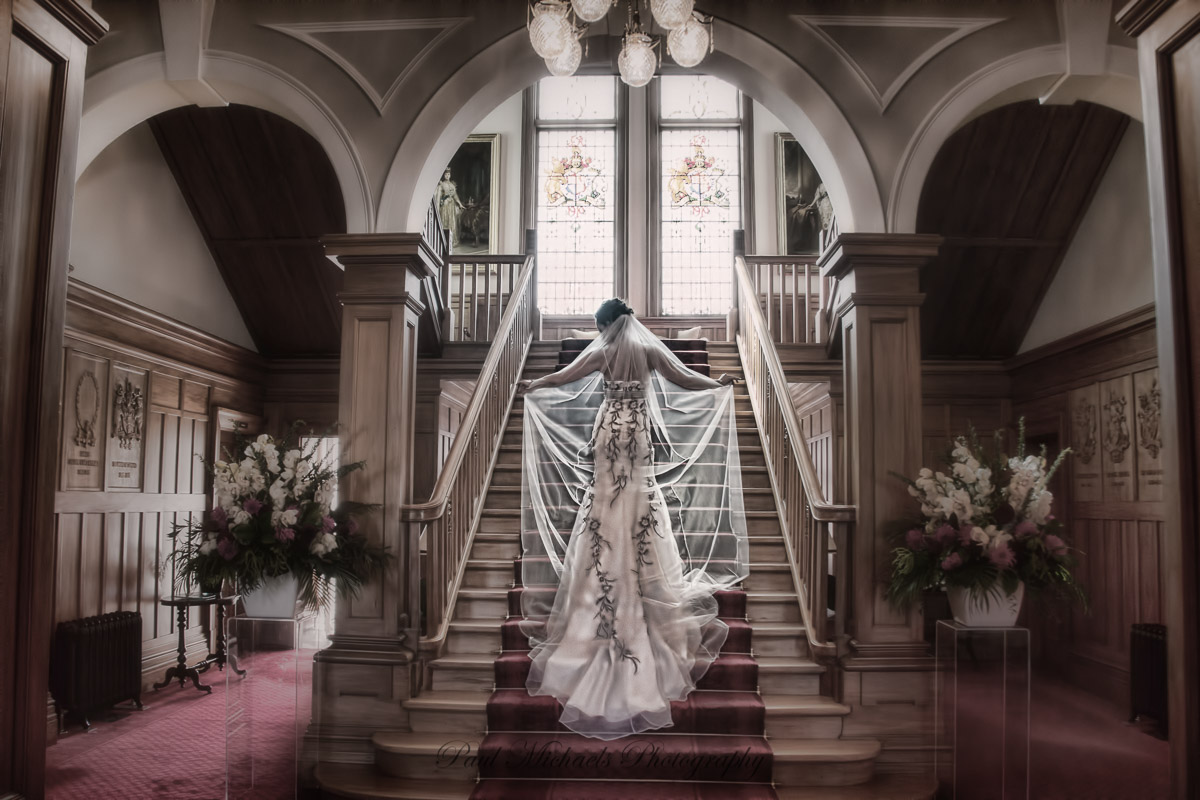 Bride walking up the stairs at government house
