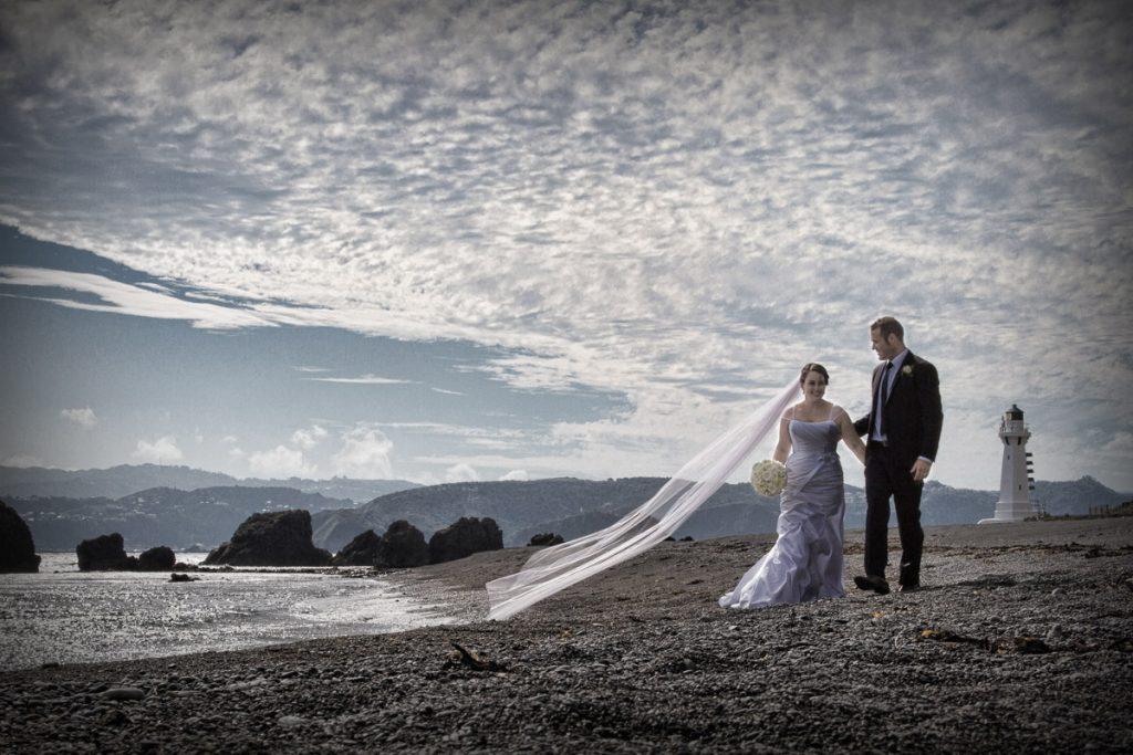 bride and groom at Pencarrow beach